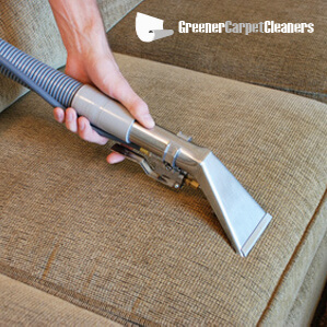 Steam cleaning a sofa as part of our upholstery cleaning service in Melbourne